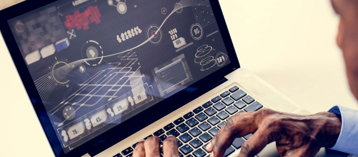 African ethnicity man working with infographic on laptop